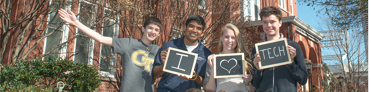 "Four students holding ""I love GT"" sign"