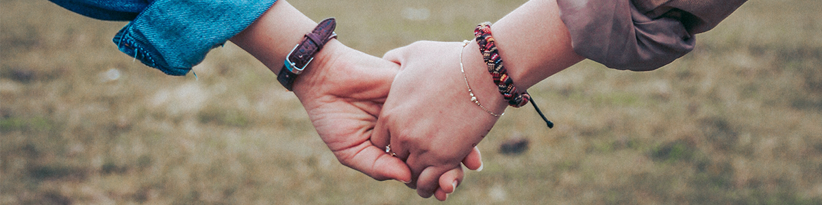 Two people holding hands.