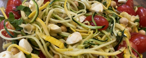 Squash and zucchini noodles with tomatoes and mozzarella