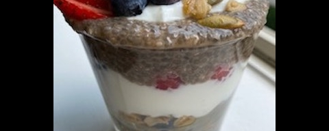 chia pudding parfait with yogurt, granola, and berries