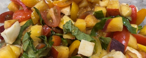 serving of diced peaches, tomatoes, mozzarella, and basil