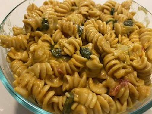 bowl of mac and cheese with vegetables